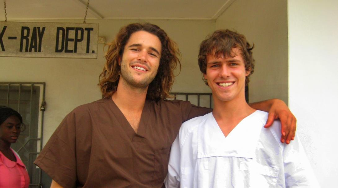 Two male Projects Abroad interns are pictured outside the surgery they have been working in whilst on their physiotherapy internship in Ghana.